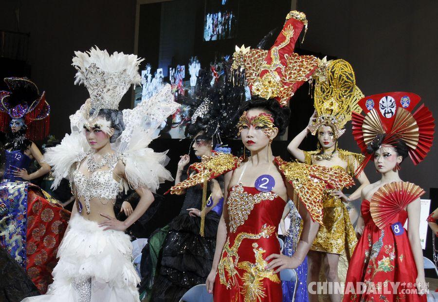 2014年12月11日,模特在展示彩妆师的创意形象设计作品.(董金林 摄)